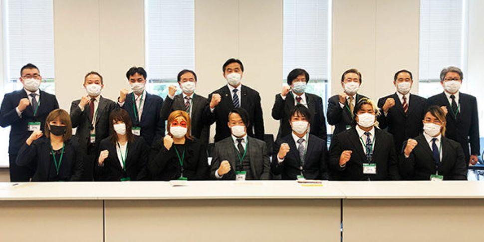 Japanese wrestling finds unity...