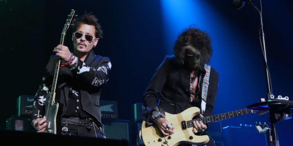 Johnny Depp Donates Guitar To...