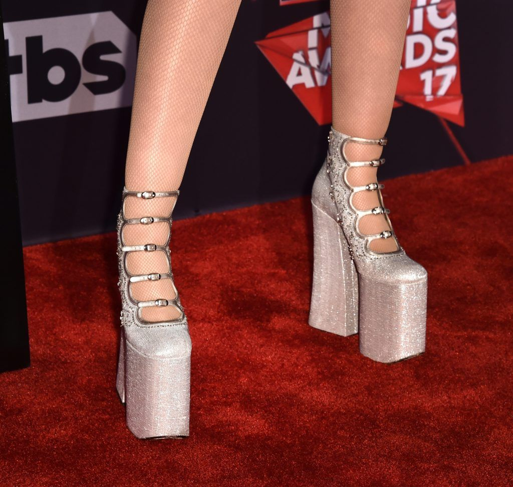 Singer Noah Cyrus, shoe detail, attends the 2017 iHeartRadio Music Awards which broadcast live on Turner's TBS, TNT, and truTV at The Forum on March 5, 2017 in Inglewood, California.  (Photo by Alberto E. Rodriguez/Getty Images)
