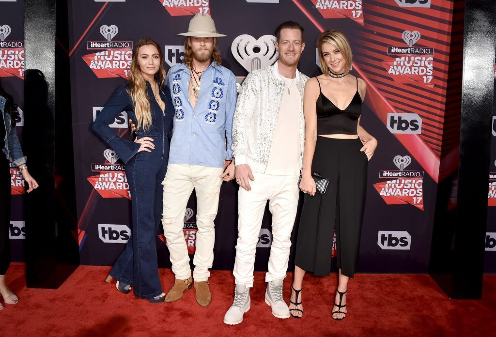 (L-R) Brittney Marie Cole, singers-songwriters Brian Kelley and Tyler Hubbard of music group Florida Georgia Line, and Hayley Stommel attend the 2017 iHeartRadio Music Awards which broadcast live on Turner's TBS, TNT, and truTV at The Forum on March 5, 2017 in Inglewood, California.  (Photo by Alberto E. Rodriguez/Getty Images)