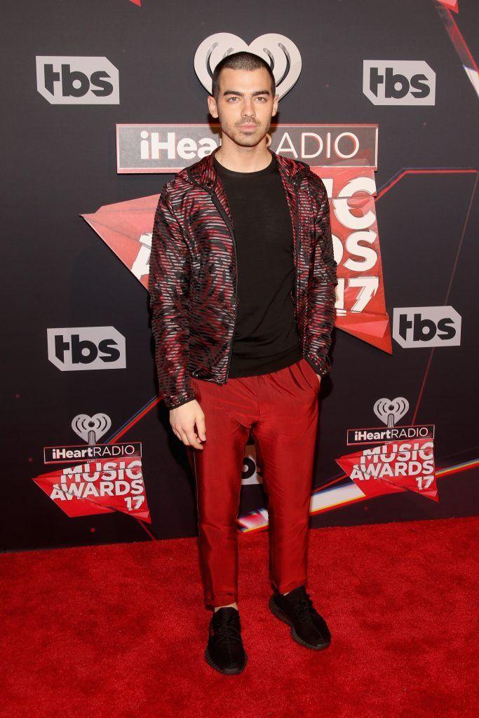 Musician Joe Jonas attends the 2017 iHeartRadio Music Awards which broadcast live on Turner's TBS, TNT, and truTV at The Forum on March 5, 2017 in Inglewood, California.  (Photo by Jesse Grant/Getty Images for iHeartMedia)