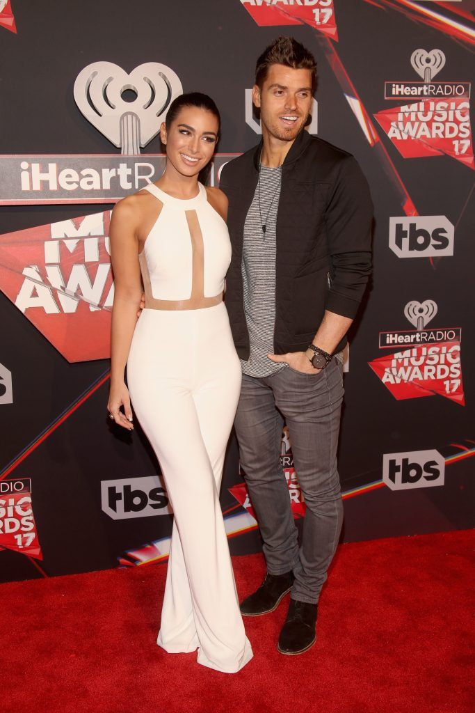 Musician Luke Pell (R) and Ashley Iaconetti attend the 2017 iHeartRadio Music Awards which broadcast live on Turner's TBS, TNT, and truTV at The Forum on March 5, 2017 in Inglewood, California.  (Photo by Jesse Grant/Getty Images for iHeartMedia)