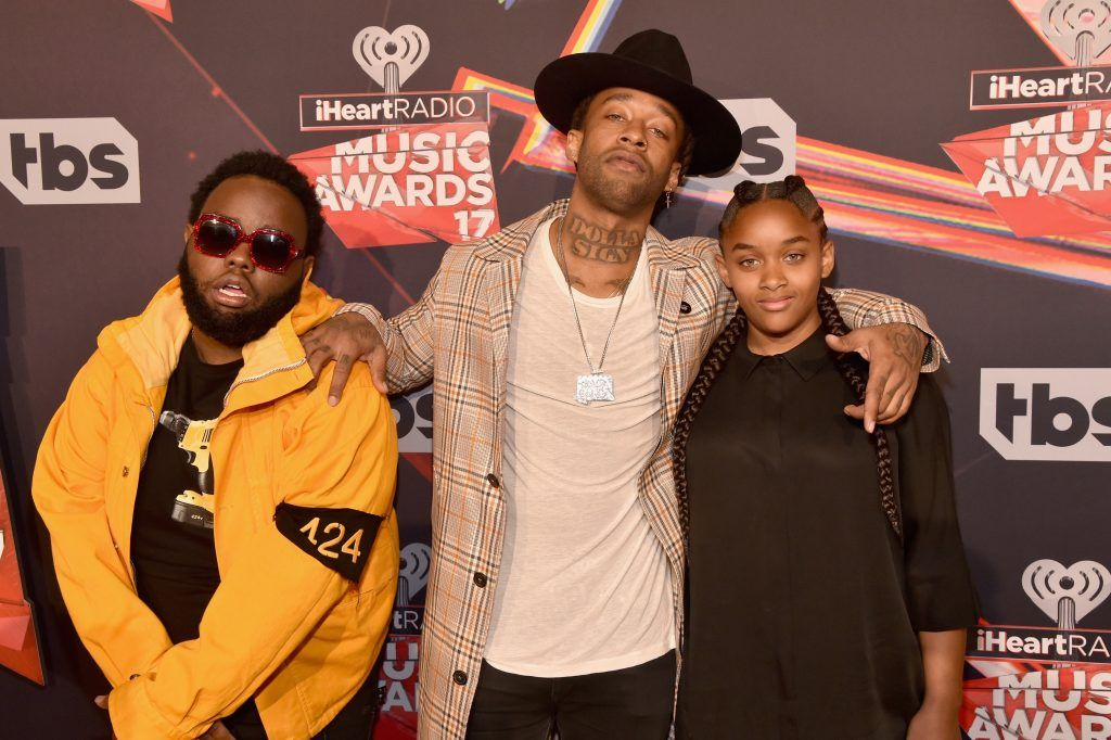 Recording artist Ty Dolla Sign (C) and Jailynn Griffin attend the 2017 iHeartRadio Music Awards which broadcast live on Turner's TBS, TNT, and truTV at The Forum on March 5, 2017 in Inglewood, California.  (Photo by Frazer Harrison/Getty Images for iHeartMedia)