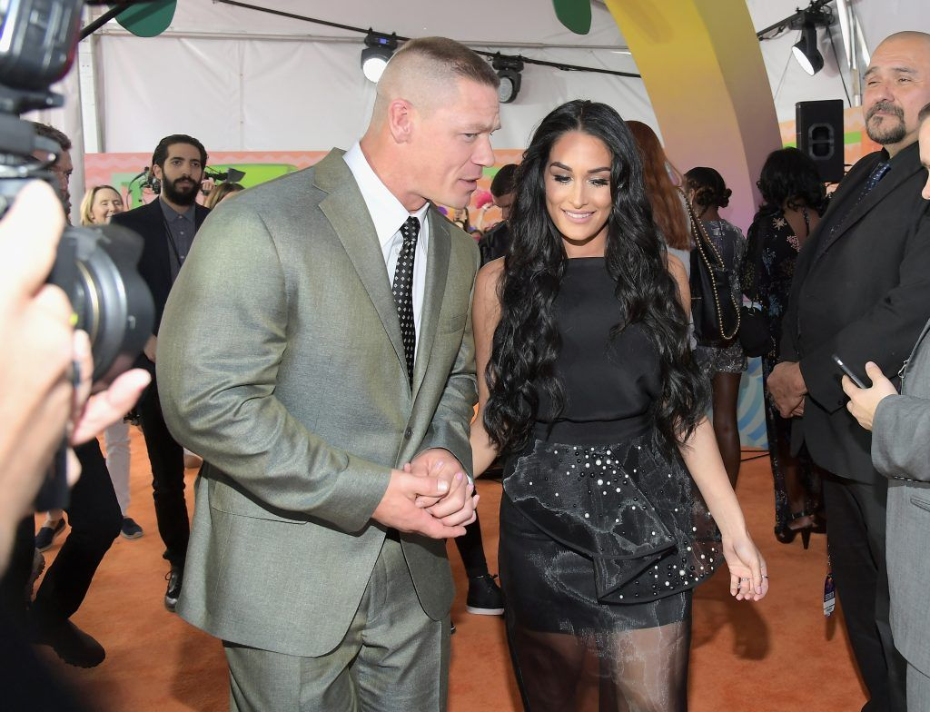 Host John Cena (L) and professional wrestler Nikki Bella at Nickelodeon's 2017 Kids' Choice Awards at USC Galen Center on March 11, 2017 in Los Angeles, California.  (Photo by Charley Gallay/Getty Images)