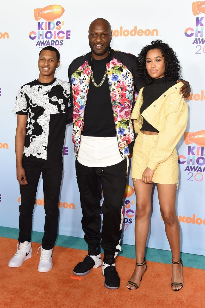 Former NBA basketball player Lamar Odom (C) arrives with guests for the 30th Annual Nickelodeon Kids' Choice Awards, March 11, 2017, at the Galen Center on the University of Southern California campus in Los Angeles. (Photo by VALERIE MACON/AFP/Getty Images)