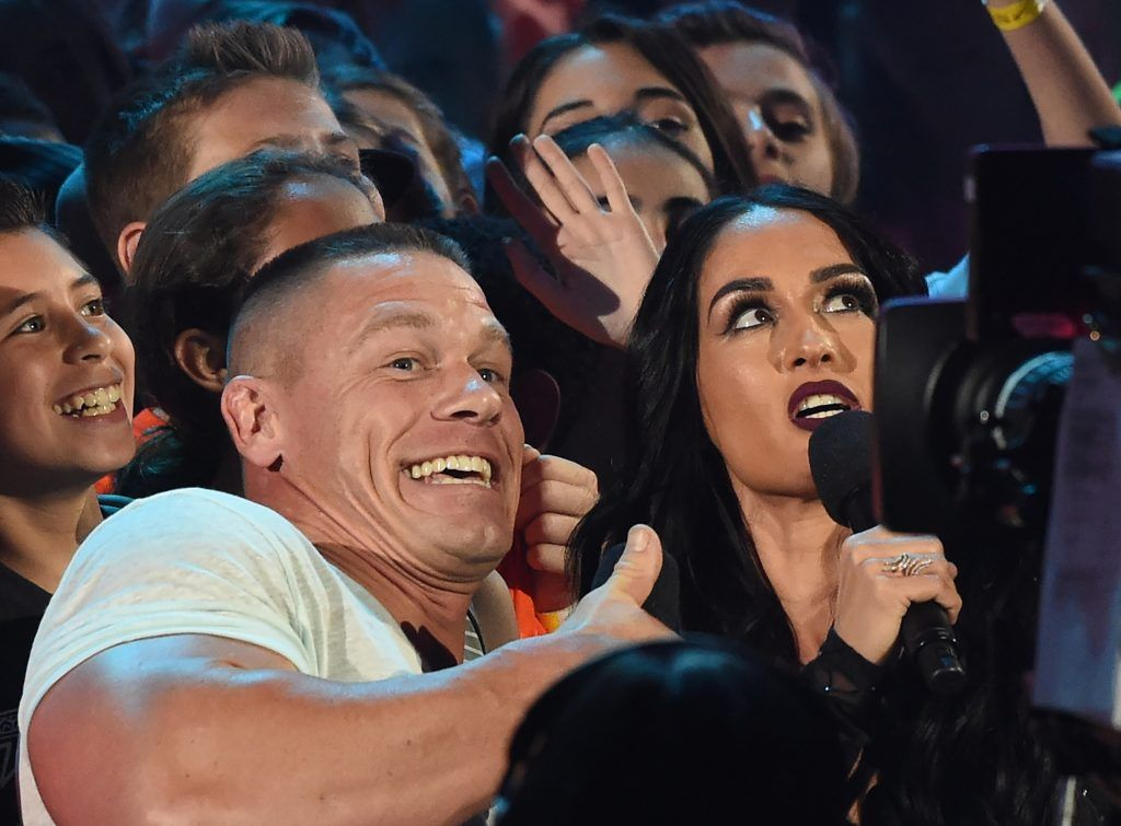John Cena and Nikki Bella on stage at the 30th Annual Nickelodeon Kids' Choice Awards, March 11, 2017, at the Galen Center on the University of Southern California campus in Los Angeles.   (Photo by VALERIE MACON/AFP/Getty Images)