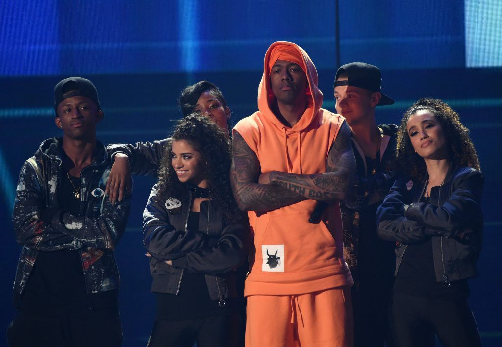 Actor Nick Cannon (C) performs onstage at Nickelodeon's 2017 Kids' Choice Awards at USC Galen Center on March 11, 2017, in Los Angeles, California. (Photo by VALERIE MACON/AFP/Getty Images)