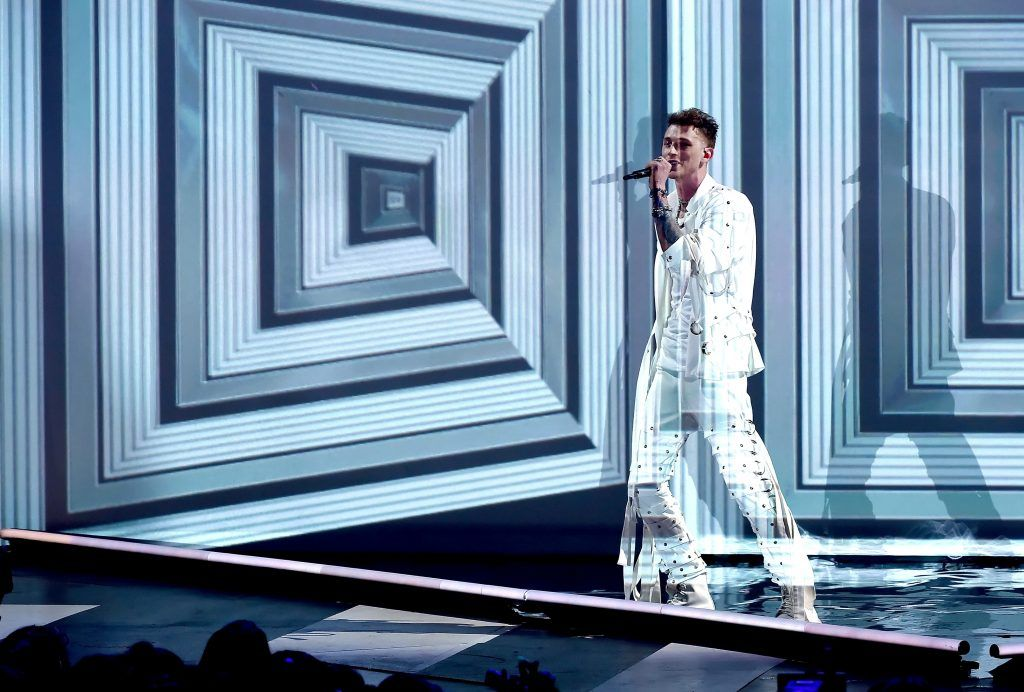 Recording artist Machine Gun Kelly performs onstage at Nickelodeon's 2017 Kids' Choice Awards at USC Galen Center on March 11, 2017 in Los Angeles, California.  (Photo by Kevin Winter/Getty Images)