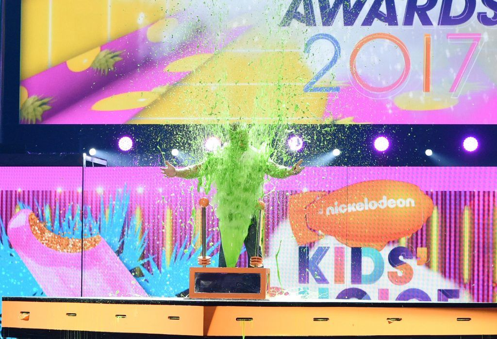 Host John Cena gets slimed onstage at Nickelodeon's 2017 Kids' Choice Awards at USC Galen Center on March 11, 2017, in Los Angeles, California. (Photo by VALERIE MACON/AFP/Getty Images)