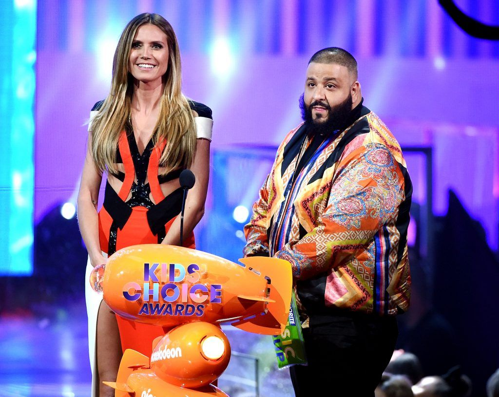 Model Heidi Klum (L) and DJ Khaled speak onstage at Nickelodeon's 2017 Kids' Choice Awards at USC Galen Center on March 11, 2017 in Los Angeles, California.  (Photo by Kevin Winter/Getty Images)