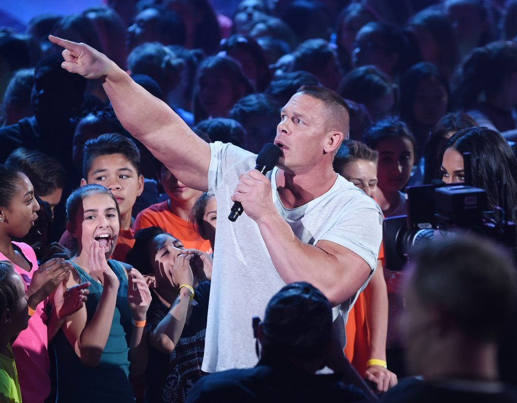 Host John Cena (L) and professional wrestler Nikki Bella speak onstage at Nickelodeon's 2017 Kids' Choice Awards at USC Galen Center on March 11, 2017 in Los Angeles, California.  (Photo by Kevin Winter/Getty Images)