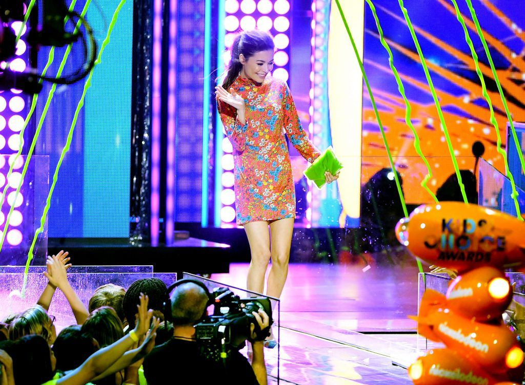 Actor Miranda Cosgrove speaks onstage at Nickelodeon's 2017 Kids' Choice Awards at USC Galen Center on March 11, 2017 in Los Angeles, California.  (Photo by Kevin Winter/Getty Images)