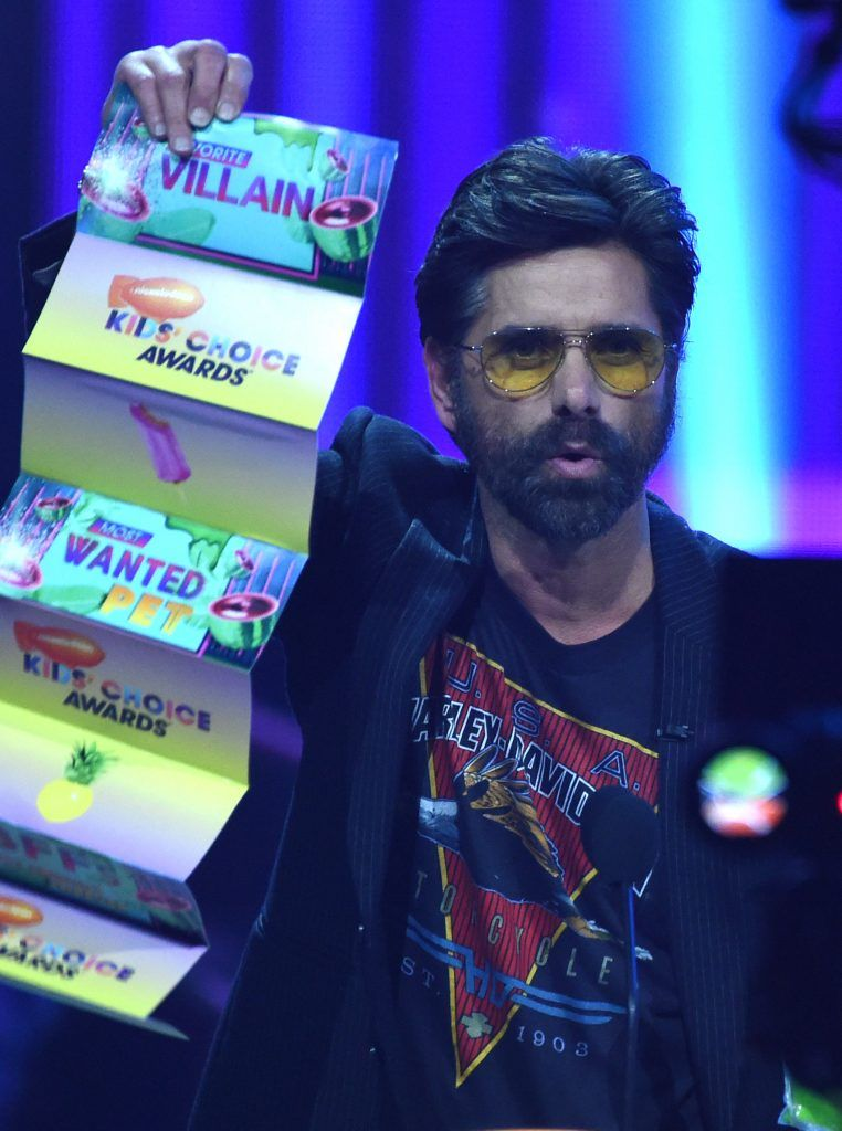 John Stamos on stage at the 30th Annual Nickelodeon Kids' Choice Awards, March 11, 2017, at the Galen Center on the University of Southern California campus in Los Angeles. (Photo by VALERIE MACON/AFP/Getty Images)