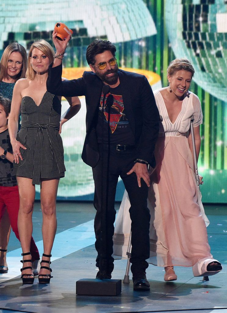 """(L-R) Candace Cameron-Bure, John Stamos and Jodie Sweetin from """"Fuller House"""" speak onstage at Nickelodeon's 2017 Kids' Choice Awards at USC Galen Center on March 11, 2017, in Los Angeles, California.    (Photo by VALERIE MACON/AFP/Getty Images)"""