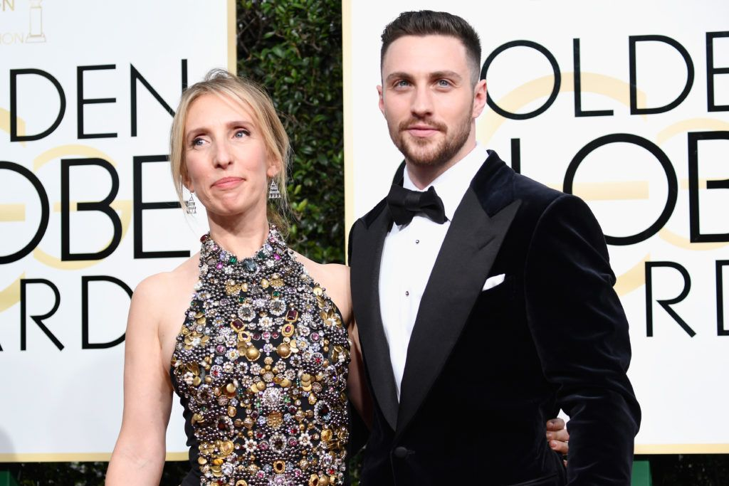 BEVERLY HILLS, CA - JANUARY 08:  Director Sam Taylor-Johnson (L) and actor Aaron Taylor-Johnson attends the 74th Annual Golden Globe Awards at The Beverly Hilton Hotel on January 8, 2017 in Beverly Hills, California.  (Photo by Frazer Harrison/Getty Images)