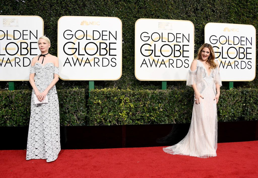 BEVERLY HILLS, CA - JANUARY 08:  Actresses Michelle Williams (L) and Drew Barrymore attend the 74th Annual Golden Globe Awards at The Beverly Hilton Hotel on January 8, 2017 in Beverly Hills, California.  (Photo by Frazer Harrison/Getty Images)