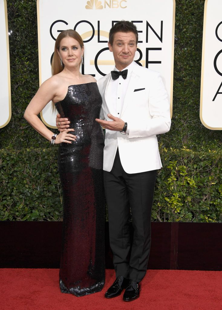 BEVERLY HILLS, CA - JANUARY 08: Actors Amy Adams and Jeremy Renner attend the 74th Annual Golden Globe Awards at The Beverly Hilton Hotel on January 8, 2017 in Beverly Hills, California.  (Photo by Frazer Harrison/Getty Images)