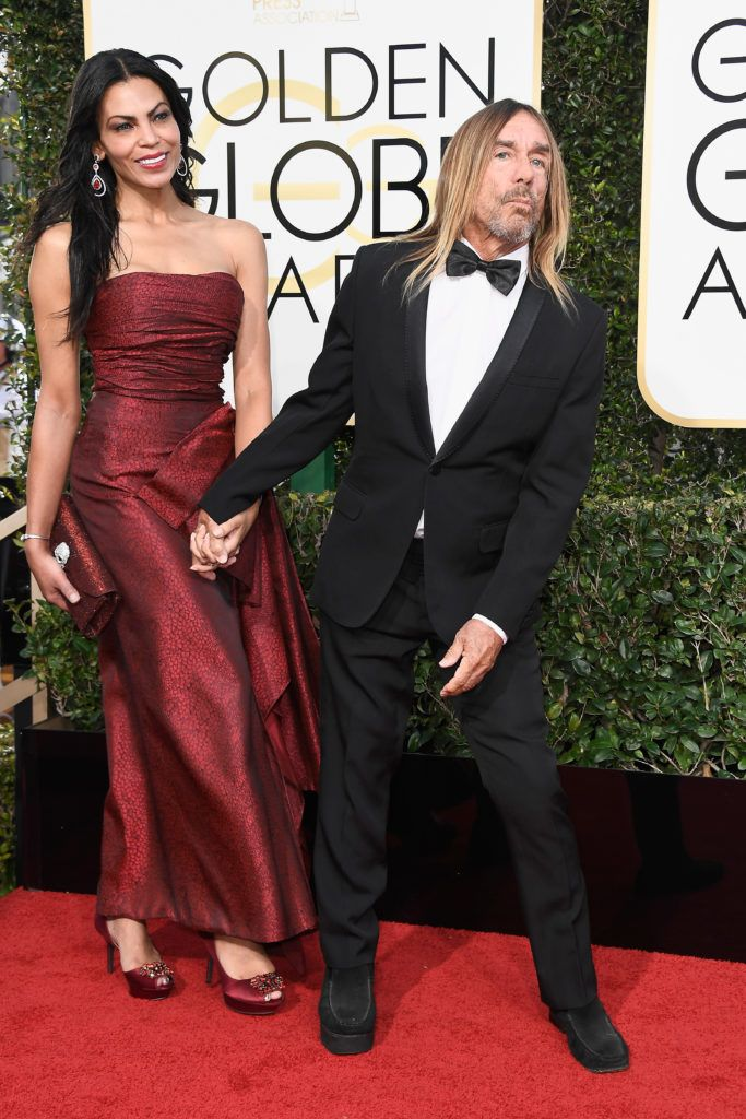 BEVERLY HILLS, CA - JANUARY 08:  Nina Alu (L) and singer Iggy Pop attends the 74th Annual Golden Globe Awards at The Beverly Hilton Hotel on January 8, 2017 in Beverly Hills, California.  (Photo by Frazer Harrison/Getty Images)