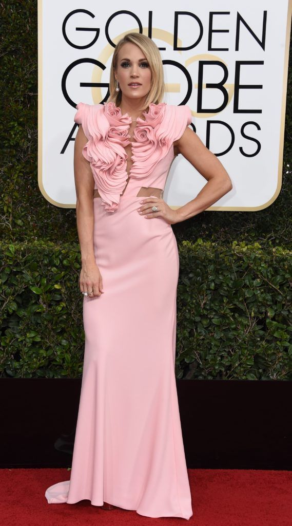 Carrie Underwood arrives at the 74th annual Golden Globe Awards, January 8, 2017, at the Beverly Hilton Hotel in Beverly Hills, California.        (Photo VALERIE MACON/AFP/Getty Images)