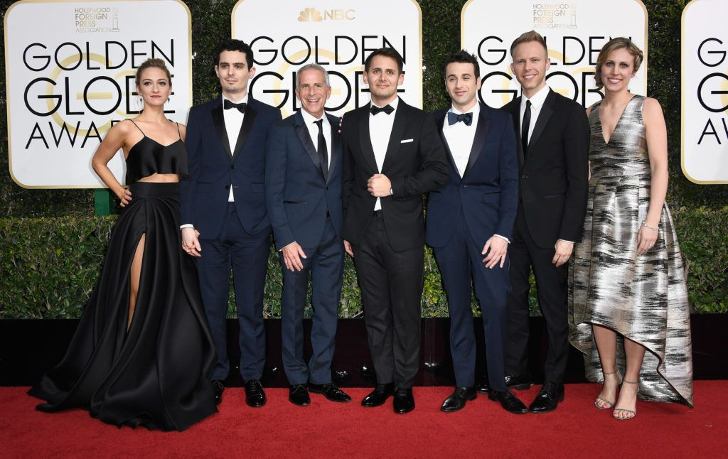 BEVERLY HILLS, CA - JANUARY 08:  (L-R) Actress Olivia Hamilton, director Damien Chazelle,  producer Marc Platt, lyricist Benj Pasek, composer Justin Hurwitz, lyricist Justin Paul and Guest attend the 74th Annual Golden Globe Awards at The Beverly Hilton Hotel on January 8, 2017 in Beverly Hills, California.  (Photo by Frazer Harrison/Getty Images)