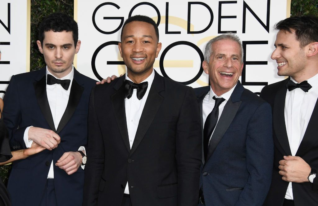 BEVERLY HILLS, CA - JANUARY 08: (L-R) Director Damien Chazelle, musician John Legend, producer Marc Platt and lyricist  Benj Pasek attend the 74th Annual Golden Globe Awards at The Beverly Hilton Hotel on January 8, 2017 in Beverly Hills, California.  (Photo by Frazer Harrison/Getty Images)