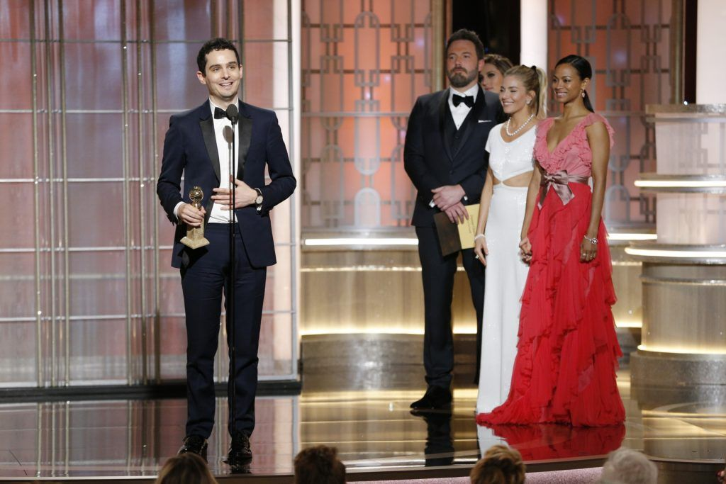 "BEVERLY HILLS, CA - JANUARY 08: In this handout photo provided by NBCUniversal, Damien Chazelle accepts the award for Best Director - Motion Picture for "" La La Land"" onstage during the 74th Annual Golden Globe Awards at The Beverly Hilton Hotel on January 8, 2017 in Beverly Hills, California. (Photo by Paul Drinkwater/NBCUniversal via Getty Images)"
