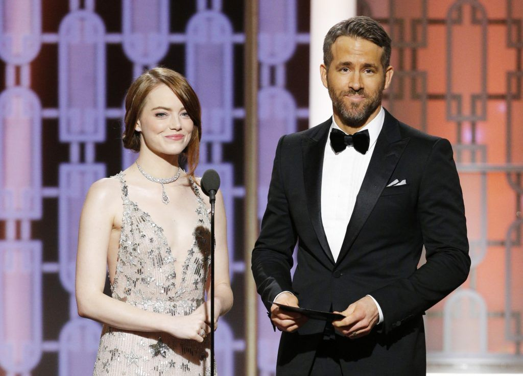 BEVERLY HILLS, CA - JANUARY 08: In this handout photo provided by NBCUniversal, presenters Emma Stone and Ryan Reynolds onstage during the 74th Annual Golden Globe Awards at The Beverly Hilton Hotel on January 8, 2017 in Beverly Hills, California. (Photo by Paul Drinkwater/NBCUniversal via Getty Images)