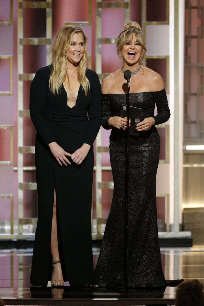BEVERLY HILLS, CA - JANUARY 08: In this handout photo provided by NBCUniversal, presenters Amy Schumer (L) and Goldie Hawn onstage during the 74th Annual Golden Globe Awards at The Beverly Hilton Hotel on January 8, 2017 in Beverly Hills, California. (Photo by Paul Drinkwater/NBCUniversal via Getty Images)