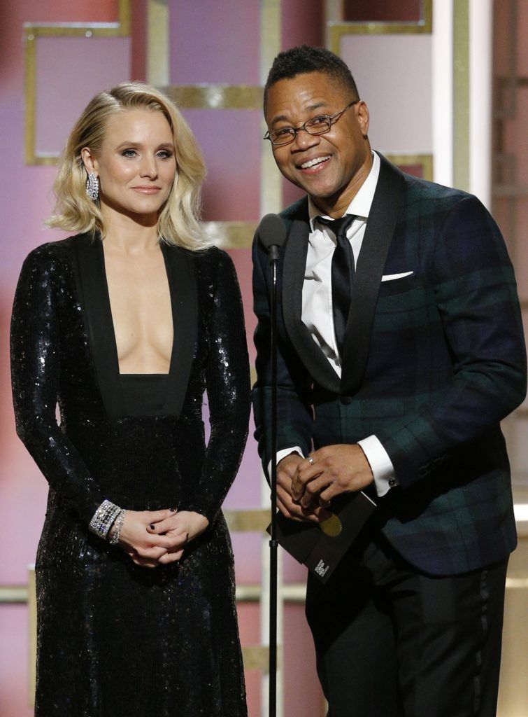 BEVERLY HILLS, CA - JANUARY 08: In this handout photo provided by NBCUniversal, presenters Kristen Bell (L) and Cuba Gooding Jr. onstage during the 74th Annual Golden Globe Awards at The Beverly Hilton Hotel on January 8, 2017 in Beverly Hills, California. (Photo by Paul Drinkwater/NBCUniversal via Getty Images)