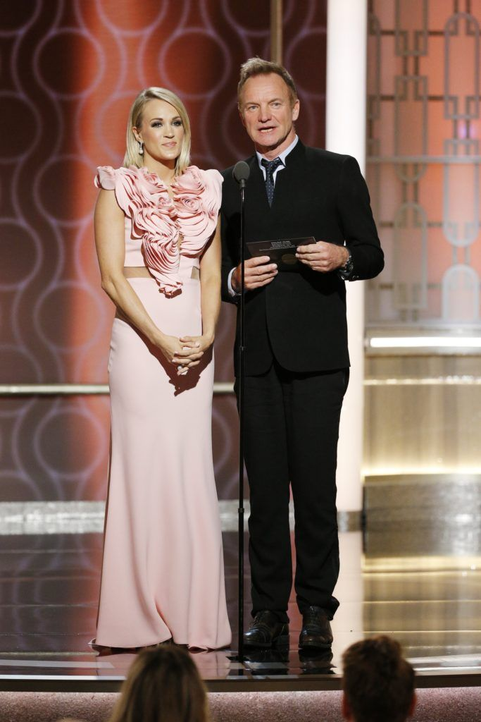 BEVERLY HILLS, CA - JANUARY 08: In this handout photo provided by NBCUniversal, presenters Carrie Underwood (L) and Sting onstage during the 74th Annual Golden Globe Awards at The Beverly Hilton Hotel on January 8, 2017 in Beverly Hills, California. (Photo by Paul Drinkwater/NBCUniversal via Getty Images)
