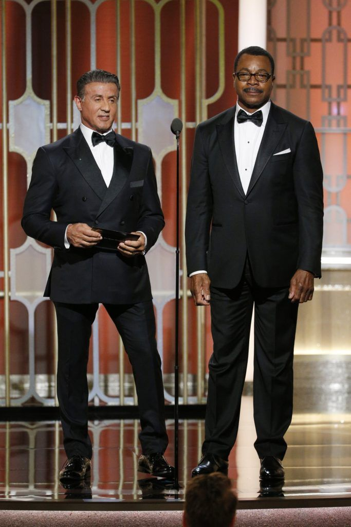 "BEVERLY HILLS, CA - JANUARY 08: In this handout photo provided by NBCUniversal, Sylvester Stallone (L) and Carl Weathers, who co-starred in the 1977 Golden Globe Award-winning film ""Rocky"", present the Golden Globe for Best Motion Picture - Drama  onstage during the 74th Annual Golden Globe Awards at The Beverly Hilton Hotel on January 8, 2017 in Beverly Hills, California. (Photo by Paul Drinkwater/NBCUniversal via Getty Images)"