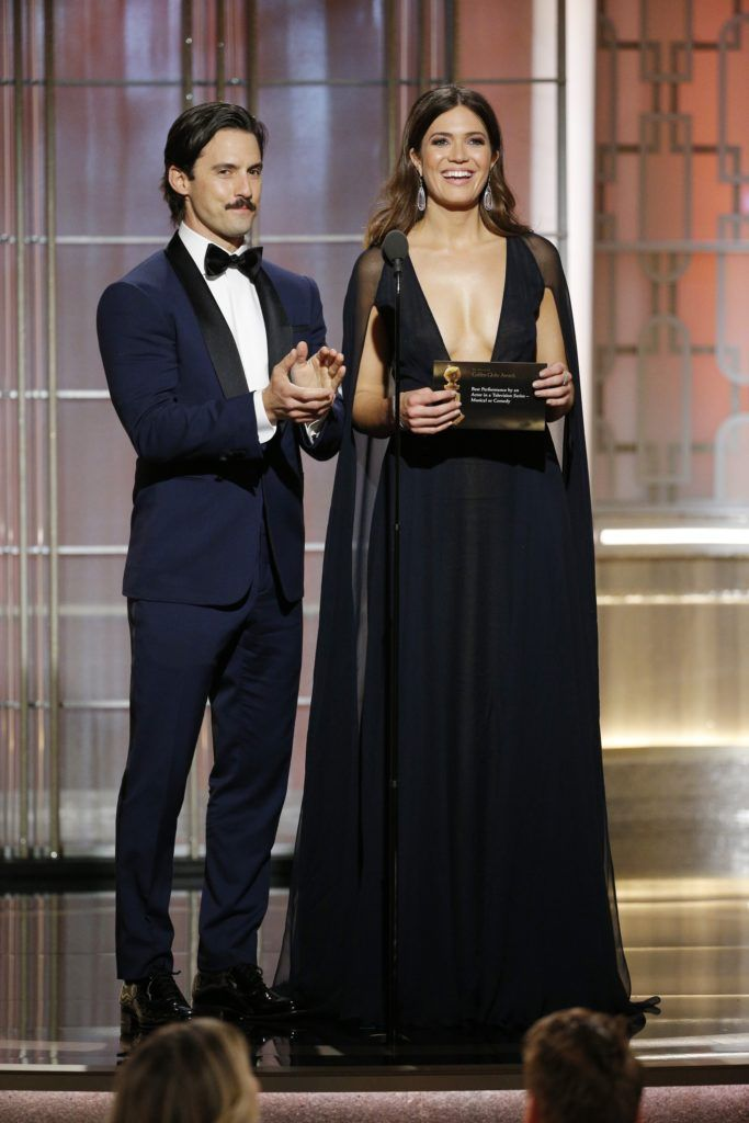 BEVERLY HILLS, CA - JANUARY 08: In this handout photo provided by NBCUniversal, presenters Milo Ventimiglia (L) and Mandy Moore onstage during the 74th Annual Golden Globe Awards at The Beverly Hilton Hotel on January 8, 2017 in Beverly Hills, California. (Photo by Paul Drinkwater/NBCUniversal via Getty Images)