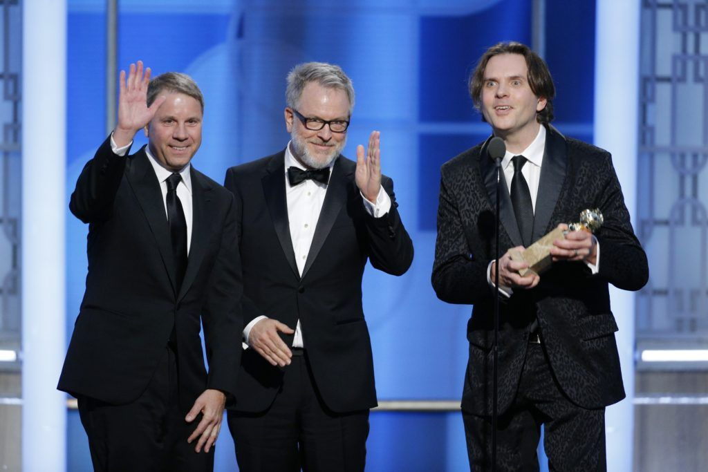 "BEVERLY HILLS, CA - JANUARY 08: In this handout photo provided by NBCUniversal, (L-R) producer Clark Spencer and directors Rich Moore and Byron Howard accept the award for Best Motion Picture - Animated for ""Zootopia"" during the 74th Annual Golden Globe Awards at The Beverly Hilton Hotel on January 8, 2017 in Beverly Hills, California. (Photo by Paul Drinkwater/NBCUniversal via Getty Images)"