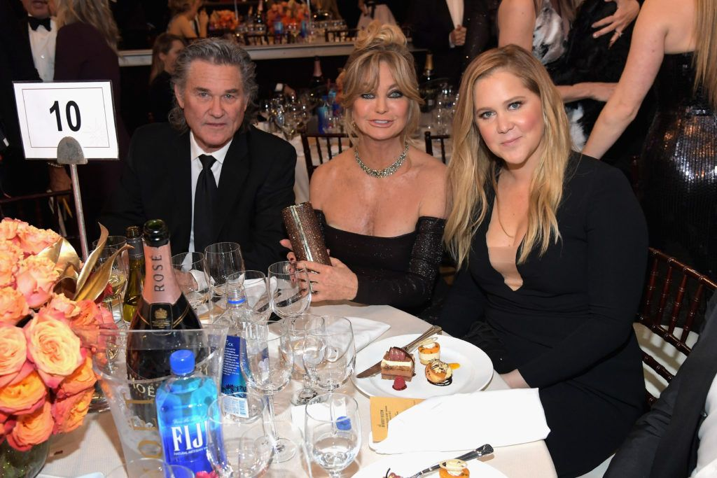 BEVERLY HILLS, CA - JANUARY 08:  Actors Kurt Russell (L), Goldie Hawn and Amy Schumer at the 74th annual Golden Globe Awards sponsored by FIJI Water at The Beverly Hilton Hotel on January 8, 2017 in Beverly Hills, California.  (Photo by Charley Gallay/Getty Images for FIJI Water)