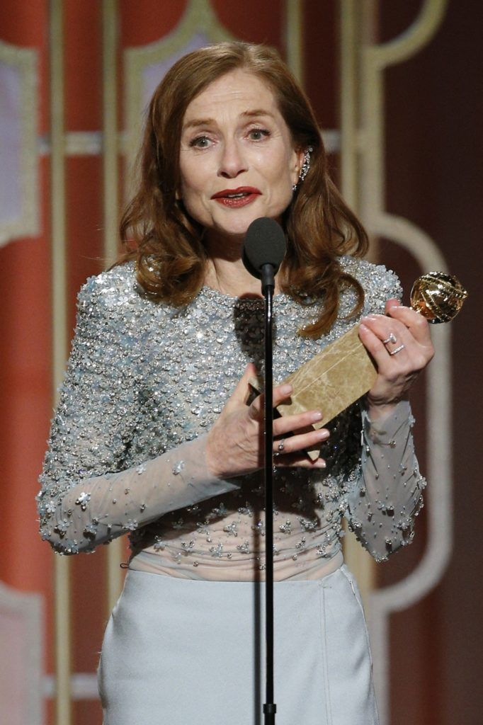 "BEVERLY HILLS, CA - JANUARY 08: In this handout photo provided by NBCUniversal, Isabelle Huppert accepts the award for Best Actress in a Motion Picture - Drama for her role in ""Elle"" onstage during the 74th Annual Golden Globe Awards at The Beverly Hilton Hotel on January 8, 2017 in Beverly Hills, California. (Photo by Paul Drinkwater/NBCUniversal via Getty Images)"