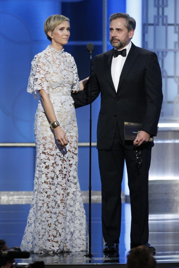 BEVERLY HILLS, CA - JANUARY 08: In this handout photo provided by NBCUniversal, presenters Kristen Wiig (L) and Steve Carell onstage during the 74th Annual Golden Globe Awards at The Beverly Hilton Hotel on January 8, 2017 in Beverly Hills, California. (Photo by Paul Drinkwater/NBCUniversal via Getty Images)