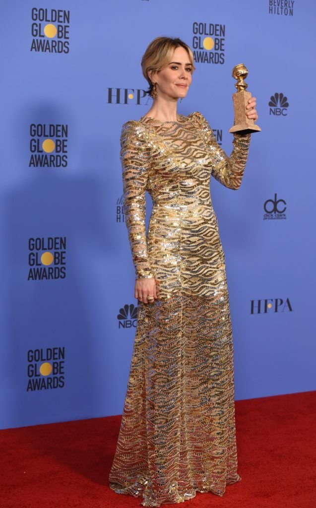 Sarah Paulson poses with the award for Best Actress in a Mini-Series for her role in The People vs. O.J. Simpson, in the press room at the 74th annual Golden Globe Awards, January 8, 2017, at the Beverly  Hilton  Hotel in Beverly Hills, California.    (Photo ROBYN BECK/AFP/Getty Images)
