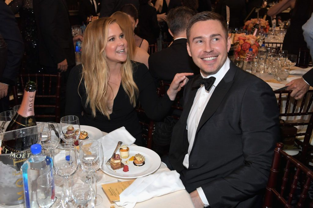 BEVERLY HILLS, CA - JANUARY 08: Actress Amy Schumer (L) and Ben Hanisch at the 74th annual Golden Globe Awards sponsored by FIJI Water at The Beverly Hilton Hotel on January 8, 2017 in Beverly Hills, California.  (Photo by Charley Gallay/Getty Images for FIJI Water)