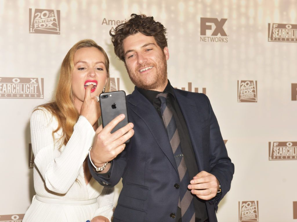 BEVERLY HILLS, CA - JANUARY 08:  Actors Leighton Meester (L) and Adam Pally attend FOX and FX's 2017 Golden Globe Awards after party at The Beverly Hilton Hotel on January 8, 2017 in Beverly Hills, California.  (Photo by Rodin Eckenroth/Getty Images)