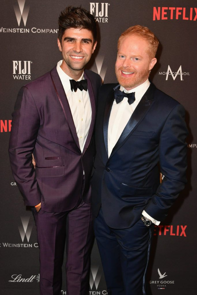 BEVERLY HILLS, CA - JANUARY 08:  Actor Jesse Tyler  Ferguson (R) and actor Justin Mikita attend The Weinstein Company and Netflix Golden Globe Party, presented with FIJI Water, Grey Goose Vodka, Lindt Chocolate, and Moroccanoil at The Beverly Hilton Hotel on January 8, 2017 in Beverly Hills, California.  (Photo by Earl Gibson III/Getty Images)