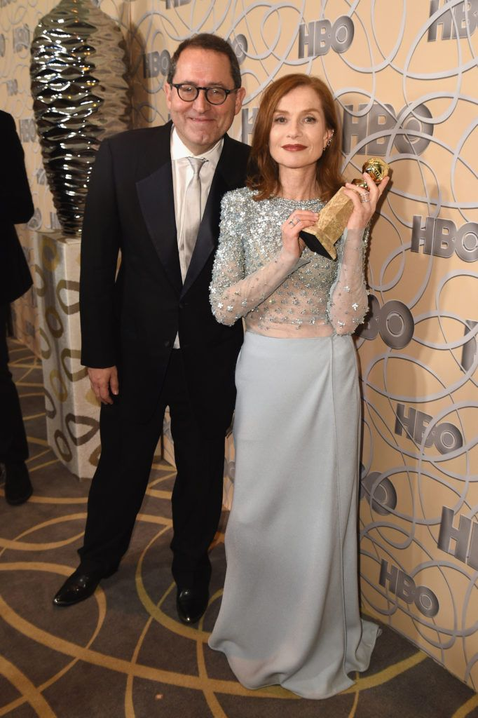 BEVERLY HILLS, CA - JANUARY 08:  Sony Pictures Classics Co-President Michael Barker and Isabelle Huppert attend HBO's Official Golden Globe Awards After Party at Circa 55 Restaurant on January 8, 2017 in Beverly Hills, California.  (Photo by Joshua Blanchard/Getty Images)
