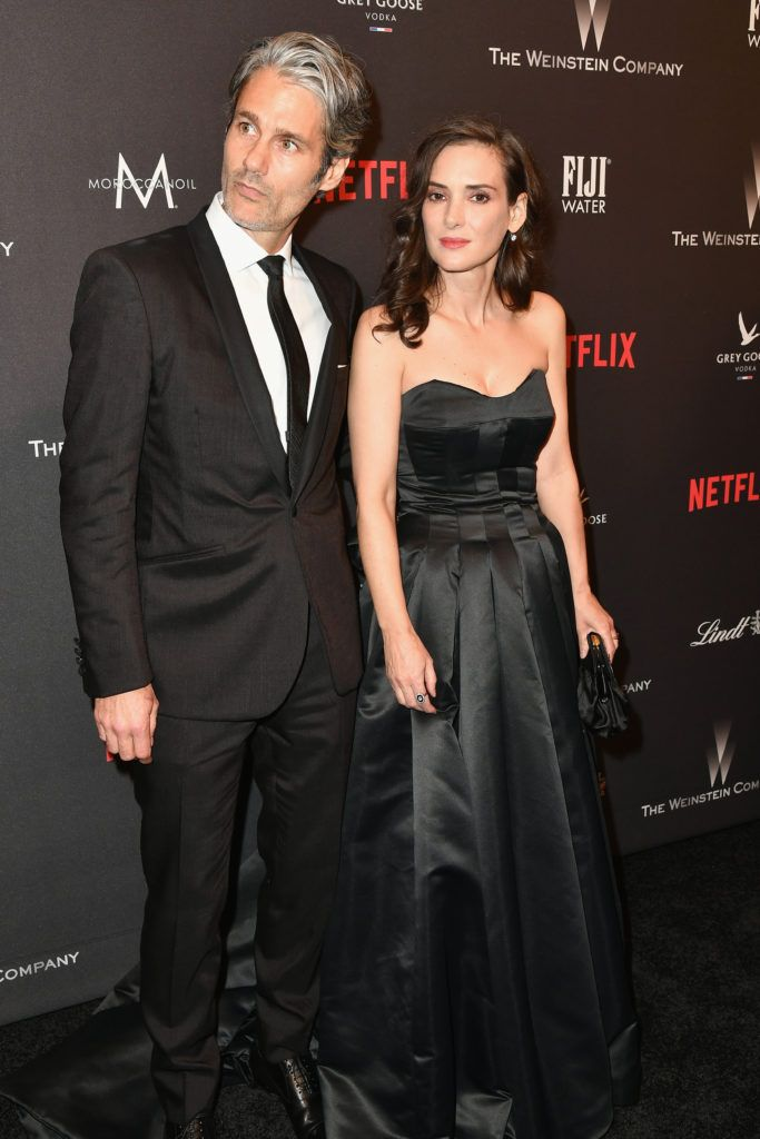 BEVERLY HILLS, CA - JANUARY 08:  Actress Winona Ryder (R) and Scott Mackinlay Hahn attend The Weinstein Company and Netflix Golden Globe Party, presented with FIJI Water, Grey Goose Vodka, Lindt Chocolate, and Moroccanoil at The Beverly Hilton Hotel on January 8, 2017 in Beverly Hills, California.  (Photo by Earl Gibson III/Getty Images)