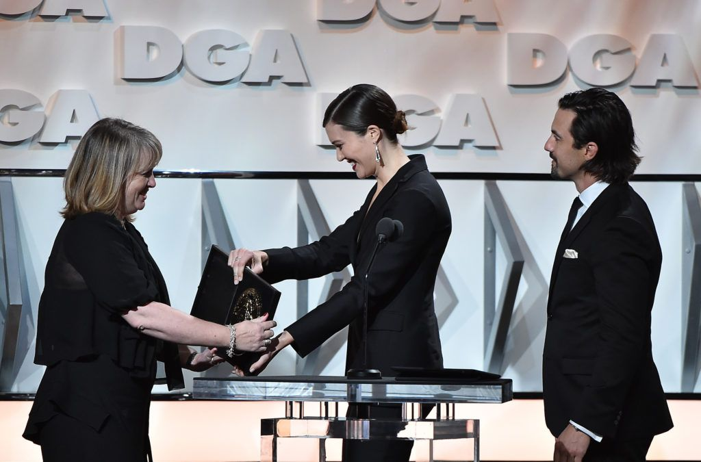 Director Becky Martin accepts the plaque for Outstanding Directorial Achievement in Comedy Series for the 'Veep' episode 'Inauguration' from actors Mandy Moore and Milo Ventimiglia, onstage during the 69th Annual Directors Guild of America Awards at The Beverly Hilton Hotel on February 4, 2017 in Beverly Hills, California.  (Photo by Alberto E. Rodriguez/Getty Images for DGA)