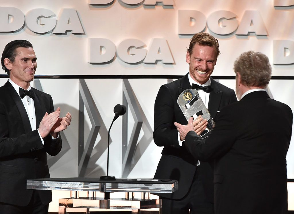 Billy Crudup and Michael Fassbender present the Lifetime Achievement in Feature Film Direction Award to Sir Ridley Scott onstage during the 69th Annual Directors Guild of America Awards at The Beverly Hilton Hotel on February 4, 2017 in Beverly Hills, California.  (Photo by Alberto E. Rodriguez/Getty Images for DGA)