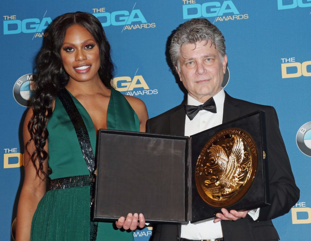Director Steven Zaillian (R), winner of the Outstanding Directorial Achievement for Movies for Television & Mini-Series for 'The Night Of,' poses with actress Laverne Cox in the press room during the 69th Annual Directors Guild of America Awards at The Beverly Hilton Hotel on February 4, 2017 in Beverly Hills, California.  (Photo by Frederick M. Brown/Getty Images)