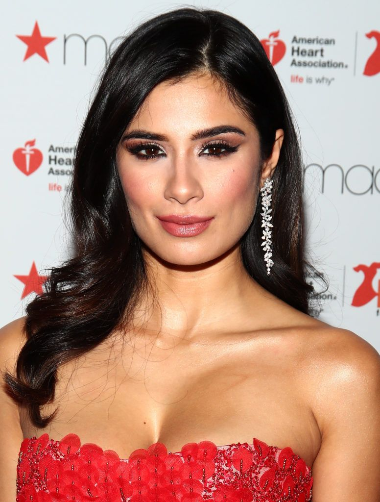 Diane Guerrero prepares backstage at the American Heart Association's Go Red For Women Red Dress Collection 2017 presented by Macy's at Fashion Week in New York City at Hammerstein Ballroom on February 9, 2017 in New York City.  (Photo by Astrid Stawiarz/Getty Images for AHA)