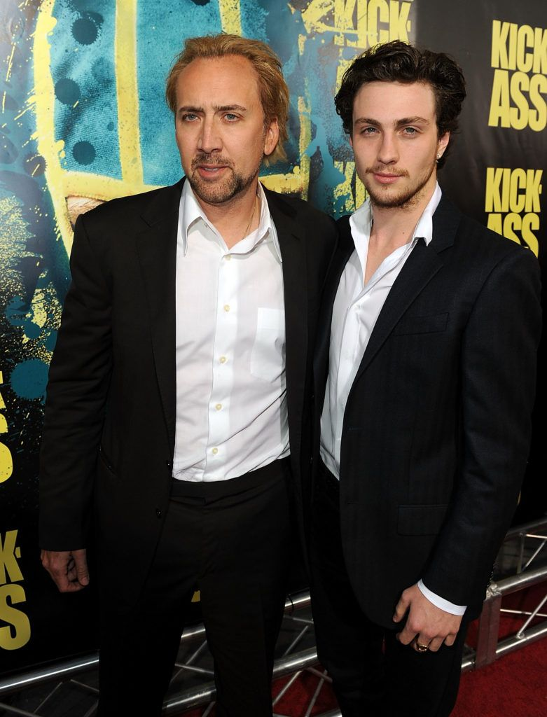 "Actors Nicolas Cage (L) and Aaron Johnson arrive at the premiere of Lionsgate's ""Kick-Ass"" held at The Cinerama Dome at the Arclight Hollywood on April 13, 2010 in Los Angeles, California.  (Photo by Kevin Winter/Getty Images)"