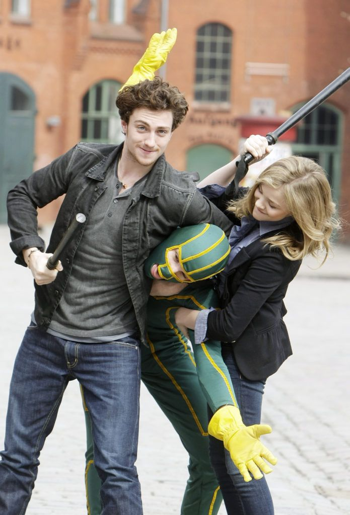 Actor Aaron Johnson, superhero character and actress Chloe Moretz attend the photocall of 'Kick-Ass' at Kulturbrauerei on March 30, 2010 in Berlin, Germany.  (Photo by Florian Seefried/Getty Images)