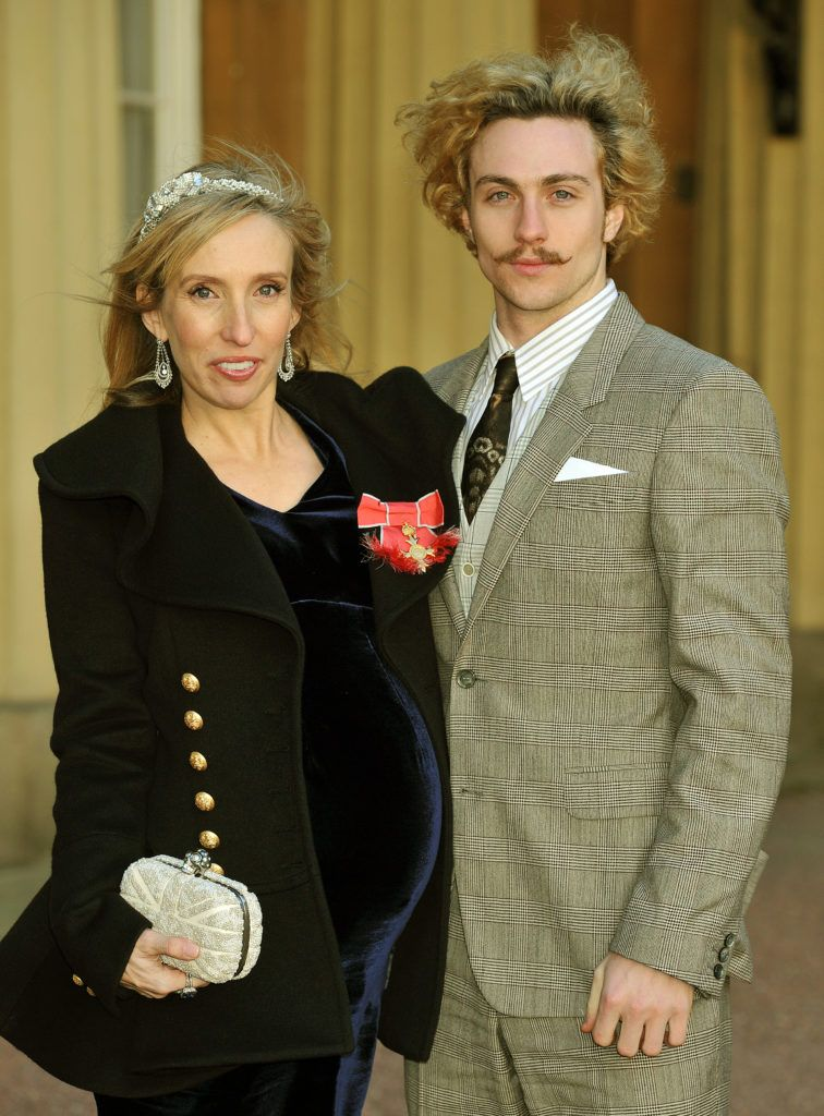Sam Taylor-Wood wears her OBE with partner Aaron Johnson, after it was presented to her by Prince Charles, Prince of Wales during an Investiture Ceremony at Buckingham Palace on December 14, 2011 in London. (Photo by John Stillwell - WPA Pool/Getty Images)