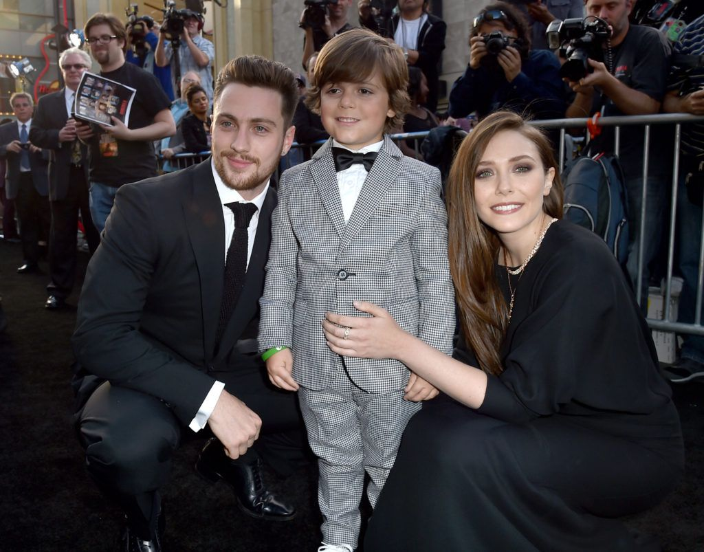 "Actors Aaron Taylor-Johnson, Carson Bolde and Elizabeth Olsen attend the premiere of Warner Bros. Pictures and Legendary Pictures' ""Godzilla"" at Dolby Theatre on May 8, 2014 in Hollywood, California.  (Photo by Kevin Winter/Getty Images)"